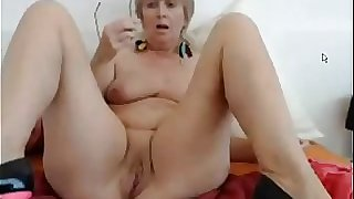 Huge-boobed mature dildoing her muff and ass on webcam